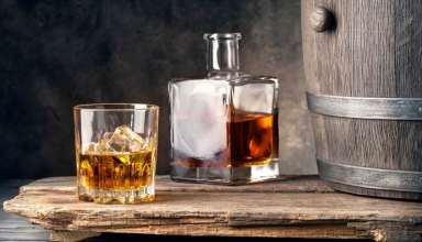 Whiskey on wooden table
