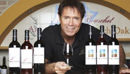 Sir Cliff Richard with his wine in his winery, Vida Nova