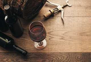 Wine glasses, corkscrew and barrel