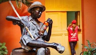Havana, Cuba - statue of sitting man holding a Havana bottle