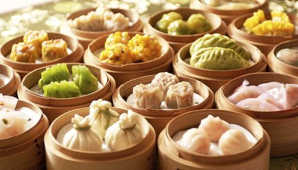 An assortment of dim sum in bamboo steamers