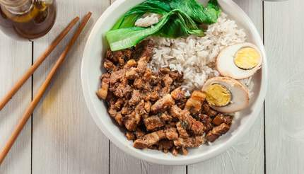 Lu rou fan over rice with boiled egg and pak choi