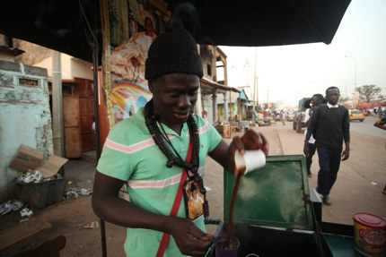 A hawker selling café Touba in Senegal