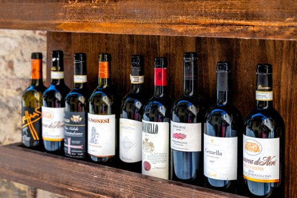 Bottles of red wine on display in Tuscany
