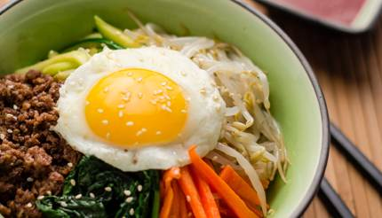 Bibimbap - rice topped with a sunnyside up, seasoned vegetables and beef