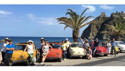 Tourists in front of Classic Convertible Fiat 500s