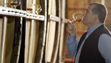 Man drinking brandy fresh from the barrel