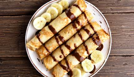 Crêpes with chocolate sauce and banana slices