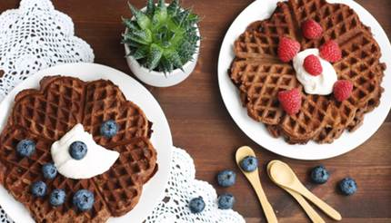 Waffles with berriesWaffles with blueberries and raspberries on cream